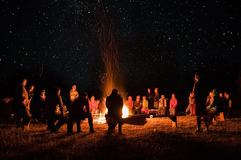 enjoy a bonfire with friends at our fall group events